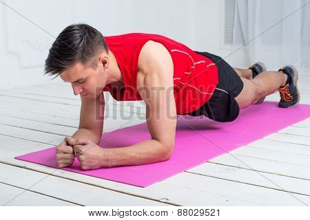 fitness training athletic sporty man doing plank exercise in gym or home concept exercising workout