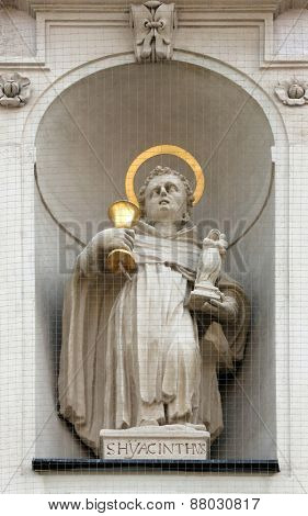 VIENNA, AUSTRIA - OCTOBER 10: Saint Hyacinth on the facade of Dominican Church in Vienna, Austria on October 10, 2014. Famous baroque church was completed in 1634.