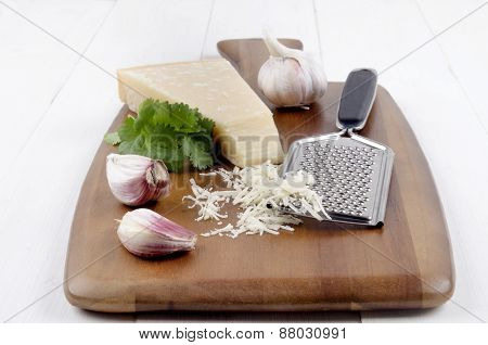 Italian Parmesan Cheese With Garlic, Fresh Coriander And Grater
