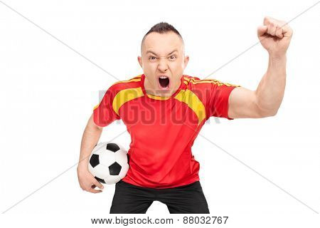Ecstatic young sports fan in a red football jersey holding a football and cheering isolated on white background