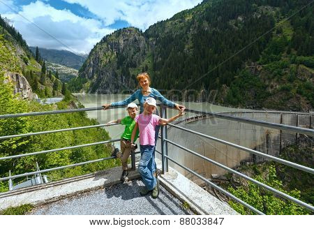 Family Near Dam ( Switzerland)