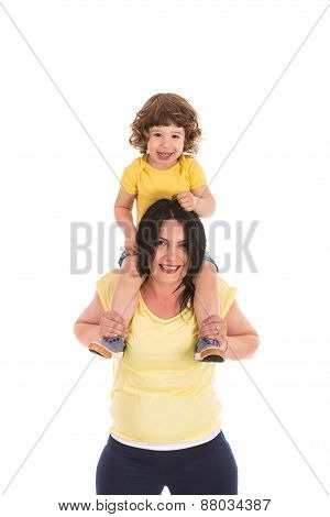 Mother Carrying Boy On Her Shoulders