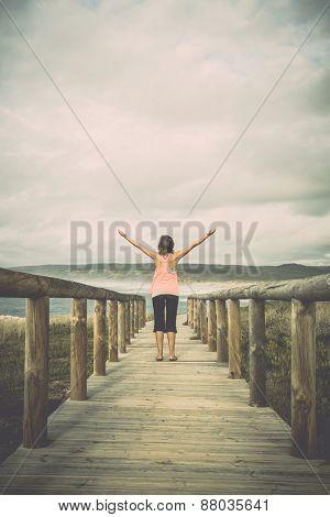 Beautiful young woman enjoying the freedom