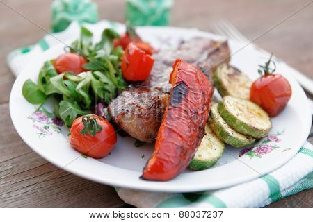 New York steak with vegetables shot outdoor, close-up
