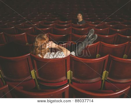 Woman On Phone Annoying Man In Auditorium