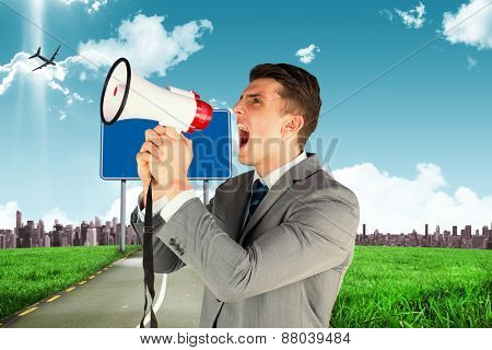 Businessman with megaphone against road leading out to the horizon
