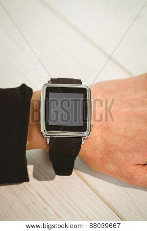 Businesswoman using a smart watch shot in studio
