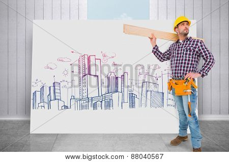 Handyman holding wood planks against composite image of white card