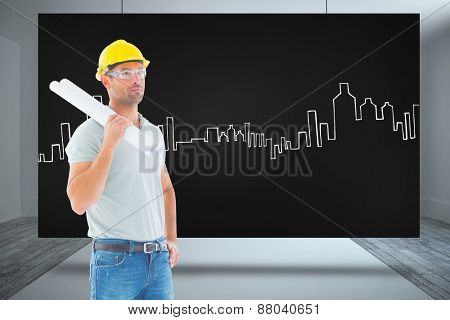 Architect with plan against composite image of black card