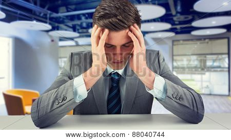Anxious businessman against college