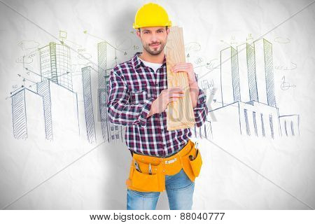 Handyman holding wood planks against crumpled white page