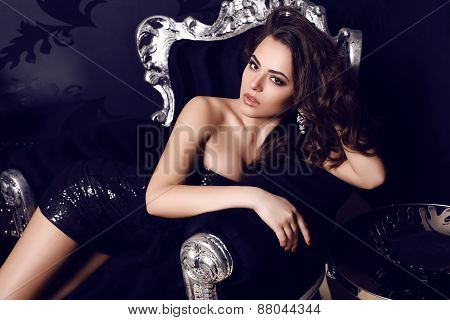 Gorgeous Woman  In Elegant Dress Posing In Luxurious Interior