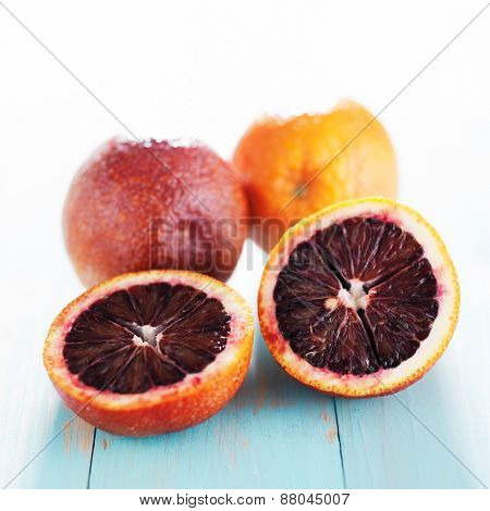 blood oranges cut in half with high key back lighting