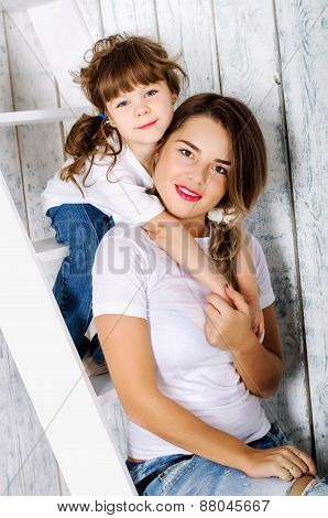 My Mother Is My Best Friend.mother And Daughter Hugging Sitting On The Stairs