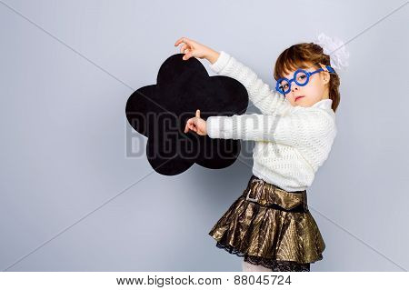 Little Girl Pointing Finger At Blackboard. Educational Concept.