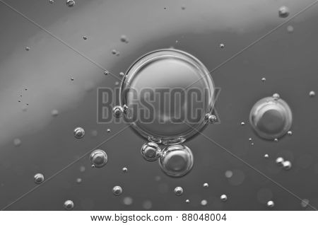 Macro Oxygen Bubbles In Water On Black-and-white Background
