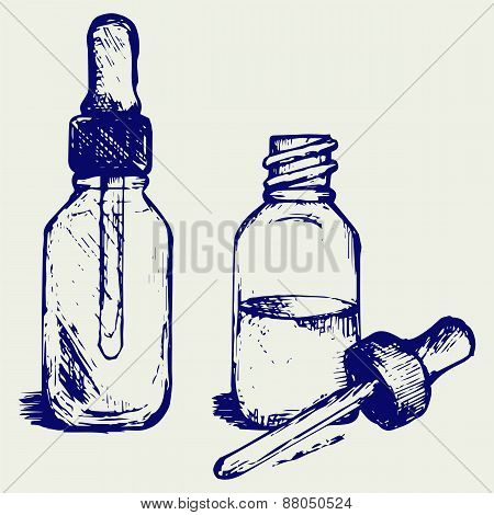 Open medicine bottle with a dropper