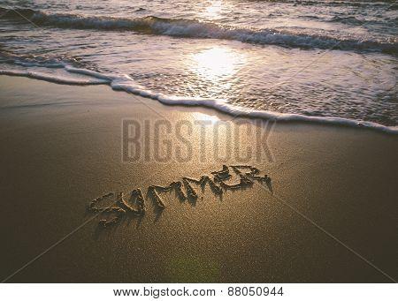 Word Summer Written In The Sand