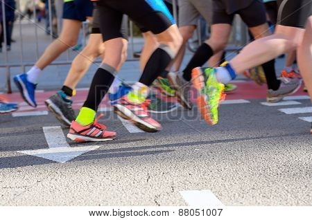 Marathon running race, runners feet on road
