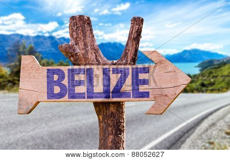 Belize wooden sign with road background