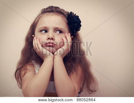 Beautiful Child Girl Looking Sad With Pouted Lips. Closeup