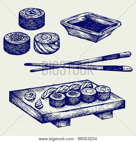 Sushi on a wooden board with chopsticks