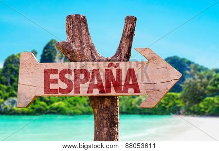 Spain (in Spanish) wooden sign with beach background