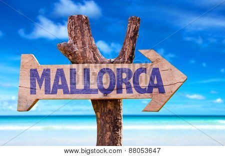 Mallorca wooden sign with beach background
