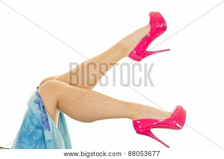 Woman Legs Up In Blue Skirt And Pink Heels