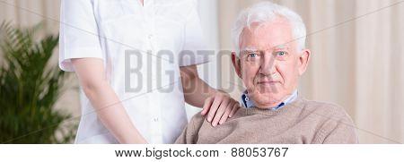 Smiling Senior Man And Nurse