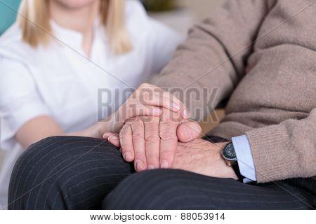 Caregiver Supporting Elder Man