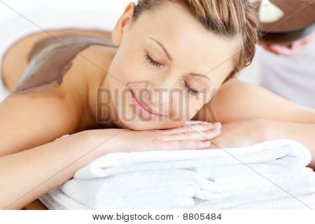 Relaxed Young Woman Enjoying A Beauty Treatment With Mud