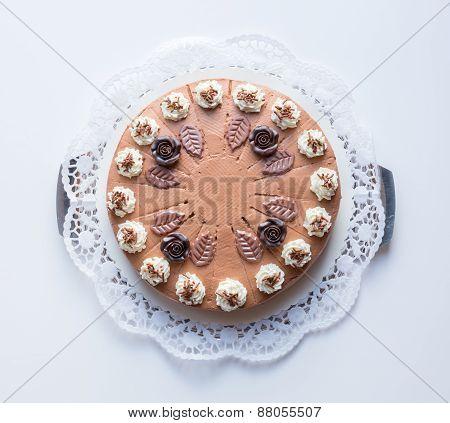 Chocolate Cream Cake On White Background With Cake Lace