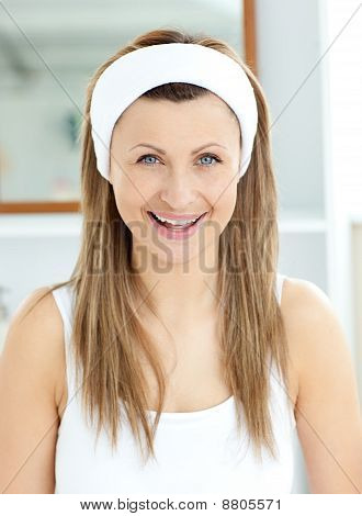 Cheerful Woman Smiling At The Camera In The Bathroom