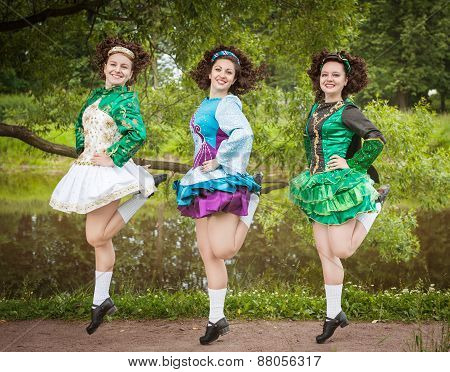 Three Young Beautiful Girls In Irish Dance Dress And Wig Dancing