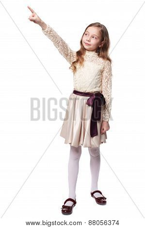 Full Length Photo Of Girl In Dress Pointing Upward. Isolated On White Background.