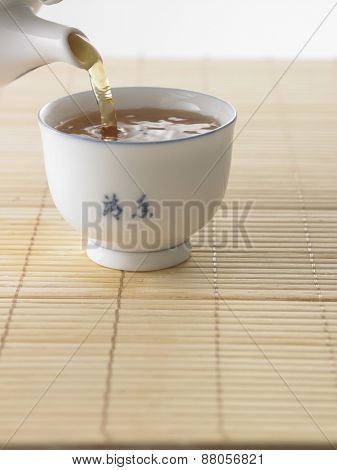 pouring tea to the cup