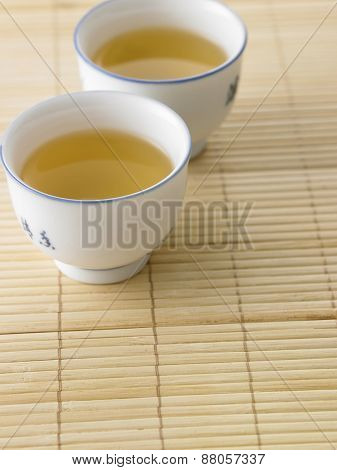 tea cup on the bamboo mat