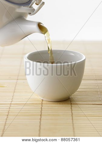 pouring tea to a cup