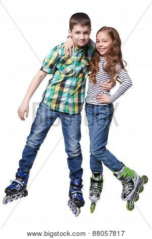 Boy And Girl With Roller Skating Hug Themself In A Studio On White Background. Isolated
