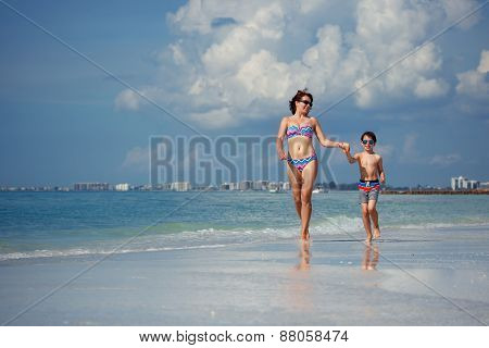 Mother and son on tropical beach