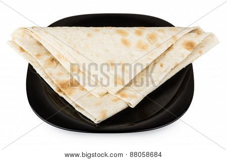 Folded Triangle Of Thin Armenian Lavash In Black Glass Plate