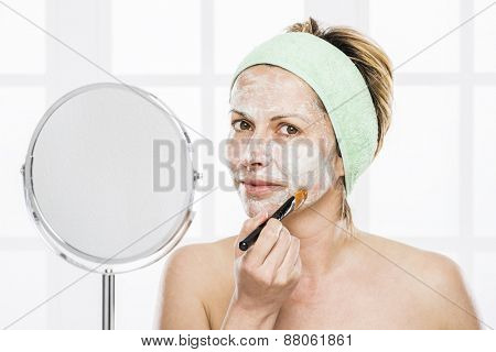 Forty years old woman putting mask on face