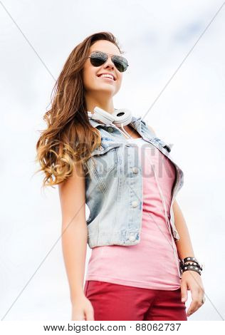 summer holidays and teenage concept - teenage girl in shades outside