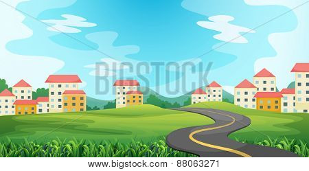 Road to the countryside with houses and field