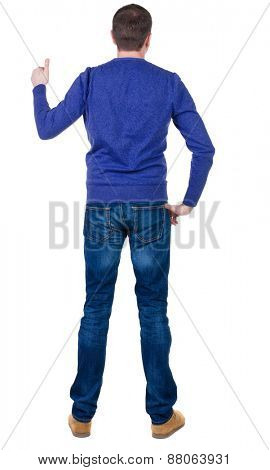 Back view of  man in blue pullove shows thumbs up. Rear view people collection.  backside view of person.  Isolated over white background.