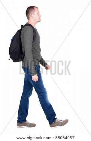 back view walking man with backpack.  brunette guy in motion. backside view of person.  Rear view people collection. Isolated over white background. young man goes to side rolling travel bag on wheels