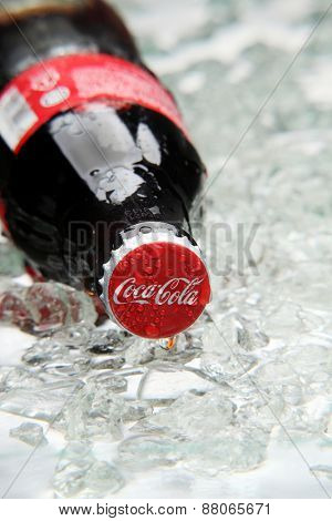 kuala Lumpur,Malaysia 15th April 2015,Editorial photo of Classic Coca-Cola Bottle in crushed ice.