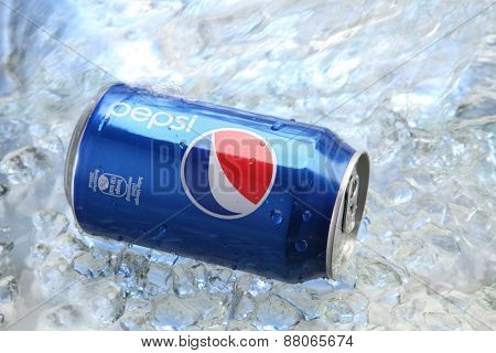 kuala Lumpur,Malaysia 15th April 2015,Can of Pepsi cola on a bed of ice and white background, Pepsi is a carbonated soft drink produced PepsiCo. Created in 1893