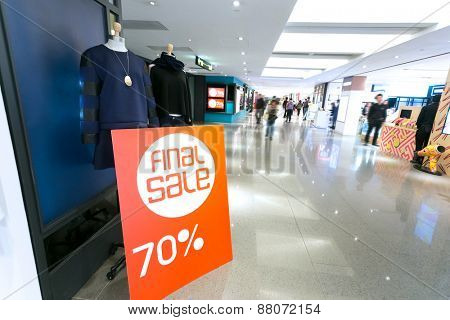 sale poster board at fashion clothes shopfront